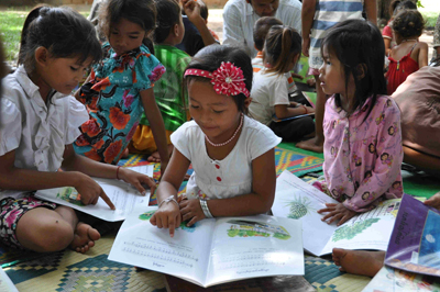 Girls pick out their own books and spend quality time reading in a village near Phnom Penh.